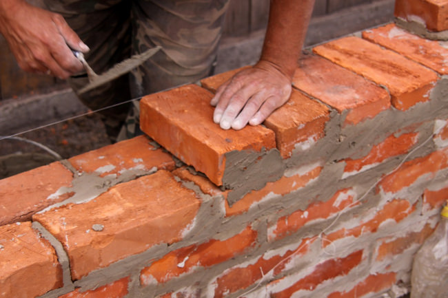 laying brick